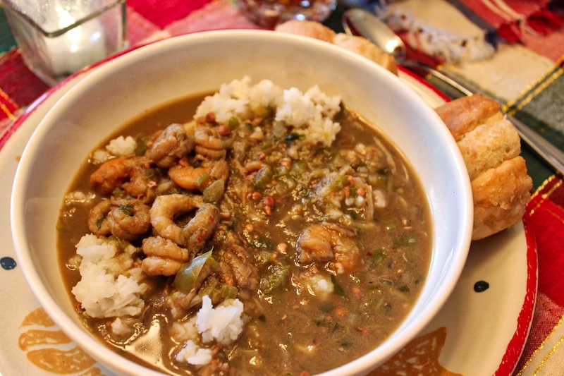 Dining on seafood gumbo served over rice